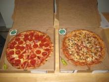 A pair of glorious meatsa pizzas.